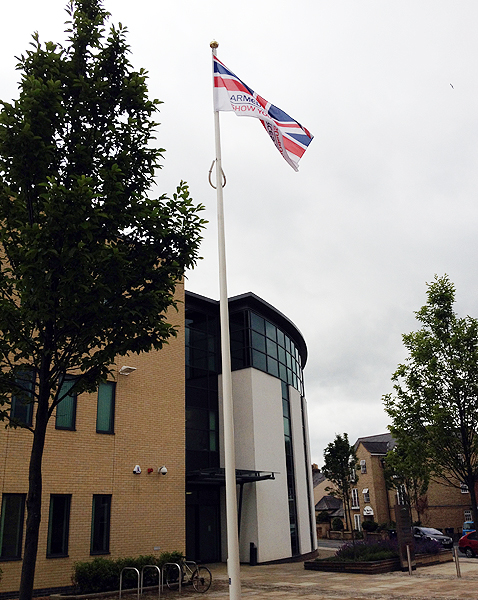 The AFD Flag in front of Pathfinder House
