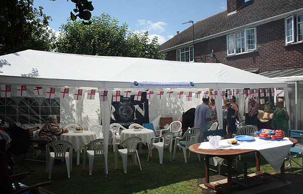 The gazebo and tables are set up for the BBQ