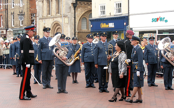 Chair of HDC, Cllr Barbara Boddington inspects the band