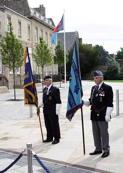 RNA and RAFA Standards with the Joint Forces Command Ensign outside of Pathfinder House