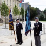Standards of the RNA and RAFA with the Joint Forces Command Ensign outside of Castle Hill House