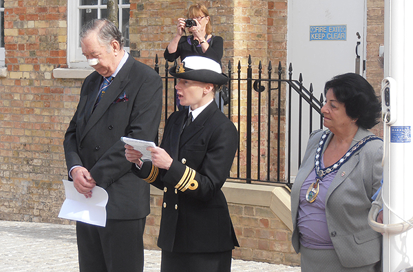 Colonel Derek Bristow and the Chairman of HDC, Cllr Barbara Boddington look on as Lt Cdr Sally Whitehall reads a prayer for the Merchant Naval Services