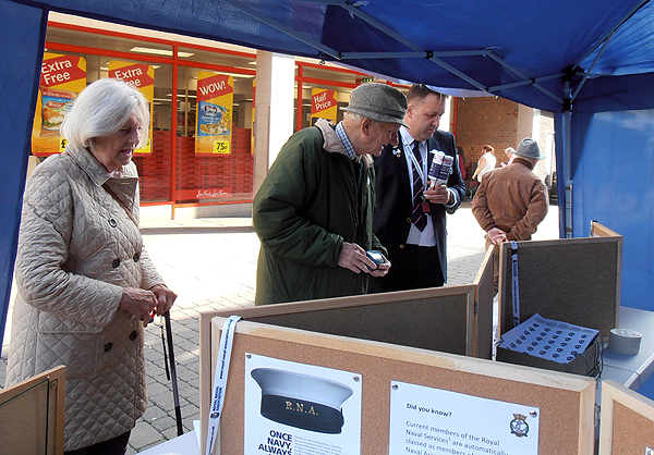 Our President, SM Graham Holt, and SM Dawn Holt are shown the stall