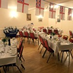 The dining hall ready for the night meal