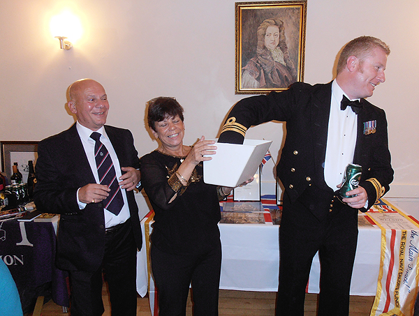 S/M Marion Twigden asks Andy Duthie to draw the first of the raffle tickets