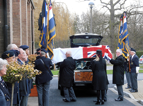Tom's coffin is carried into the chapel
