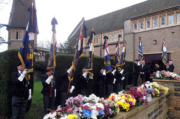 A final mark of respect as RNA Standards are paraded outside the chapel