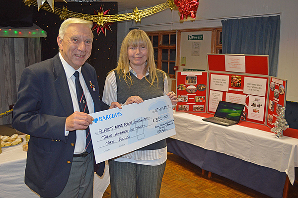 Karen Pollecutt receives a cheque from Tom Mumford, St Neots & District Branch President