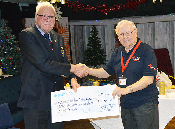 Peter Plant receives a cheque from John Gibbs,St Neots & District RNA