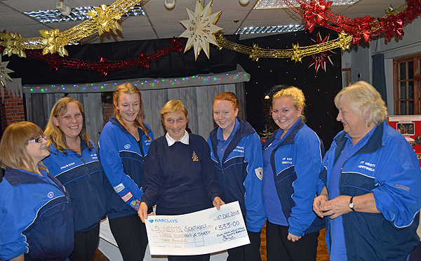 St Neots Sentinels receive a donation from St Neots & District