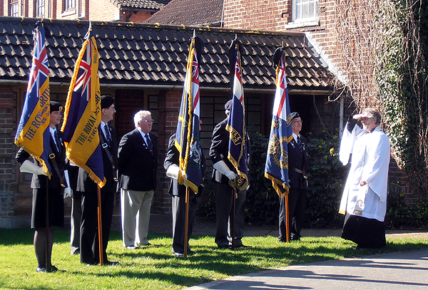 Revd Andrew Milton greets the Standard Bearers prior to the service