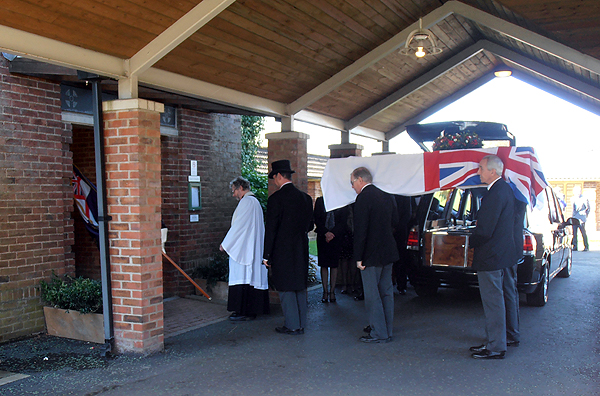Spike's coffin is carried into the Chapel