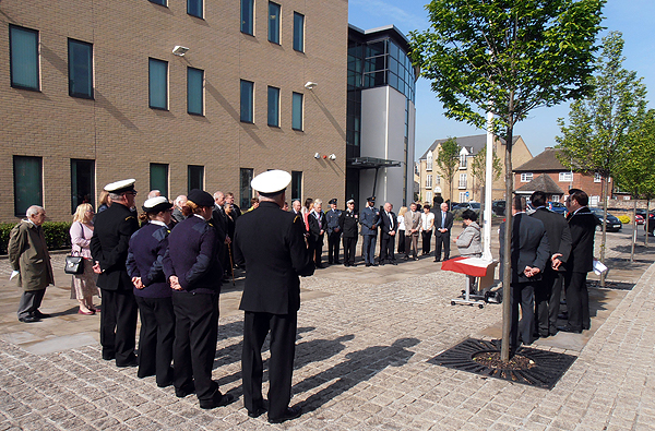 The ceremony takes place outside of Pathfinder House, HDC HQ