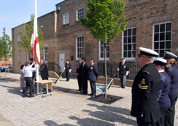 The St George flag is attached and raised by the Chair of HDC
