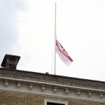 The Armed Forces Day flag is hoisted above the Town Hall