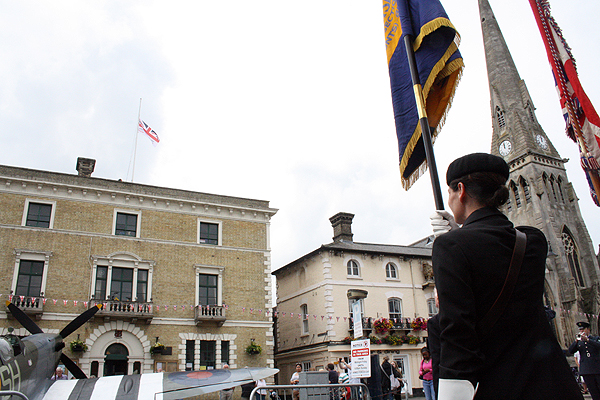 The Armed Forces Day flag is raised above the Town Hall