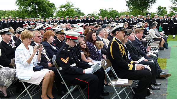 Mrs Gill Molyneux and children sits with the VVIPs (Photo: Lt Cdr Nigel Huxtable, RNA)
