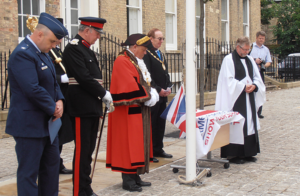 The Revd Andrew Milton gives the Blessing of the Armed Forces Day Flag