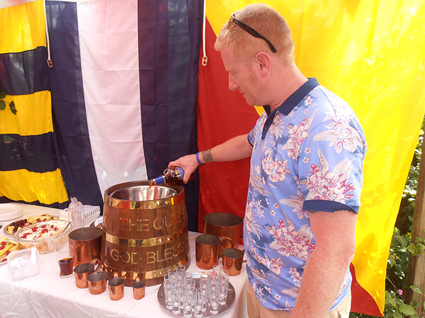 S/M Andy Duthie tops up the rum barrel for the Loyal Toast