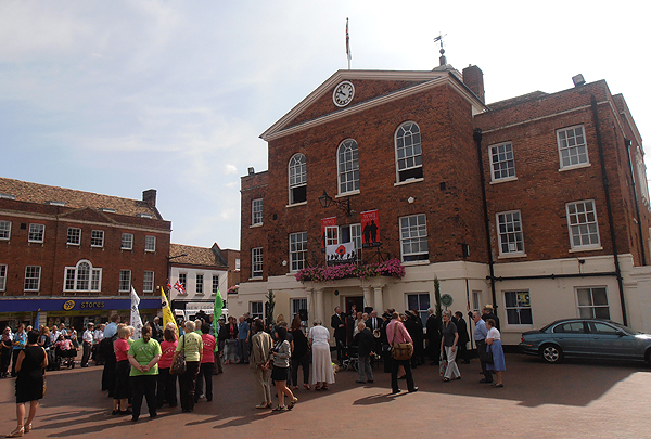 Town Councillors, members of the Armed Forces, Military Associations and guests gather at the Town Hall