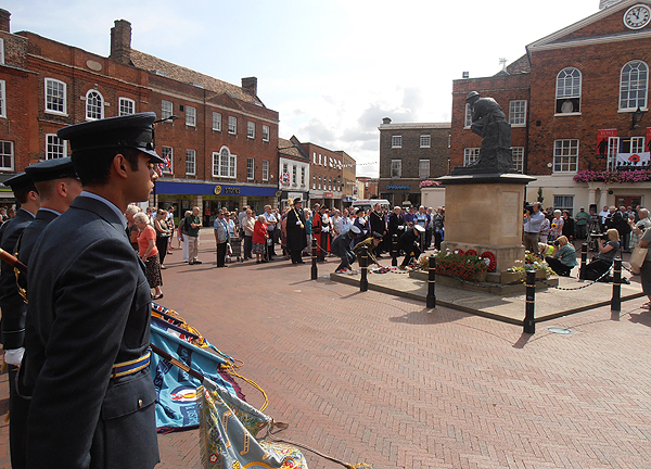 Wg Cdr Fashade, Station Commander RAF Wyton, and representatives from the Army and Navy lay flowers of Remembrance