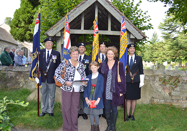 Relatives have a group photo with the Standard Bearers
