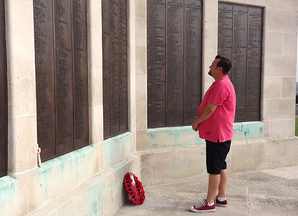 Andrew looks at the names engraved at the Commonwealth War Memorial