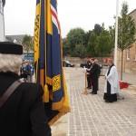 Revd Andrew Milton leads the attendees in prayer before Blessing the ensign