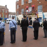 Standard Bearers face the Town Hall and Market Square