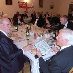 Shipmates and guests take their places in the dining hall