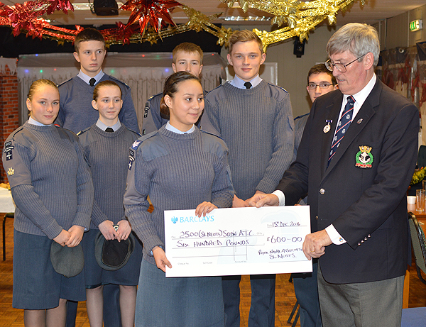 Keith Ridley presenting a cheque for £600 to the ATC