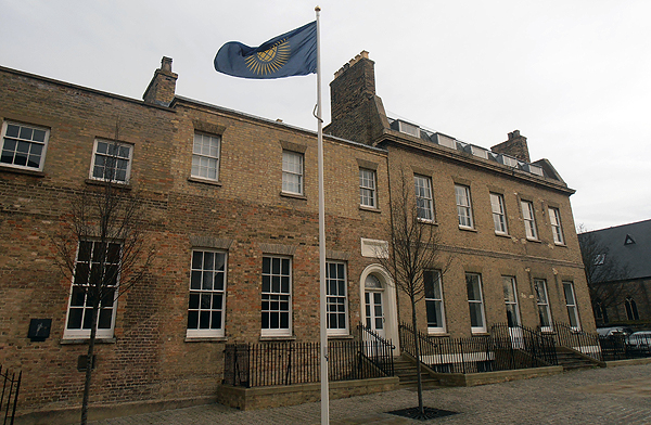 The Commonwealth Flag flying proudly outside of Castle Hill House