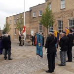Standards are dipped as the Flag of St George is hoisted