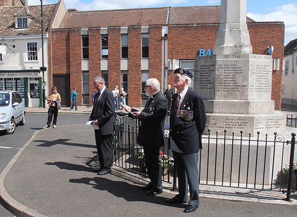 RBL members take their place in front of Clement Freeman's name engraved on the War Memorial