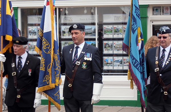 Shipmate Karl Webb parades the Branch Standard