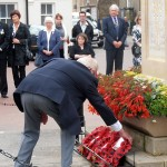 The Merchant Navy wreath is placed at the base of the memorial