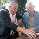 Jack Millard shows the Mayor his recently awarded medal