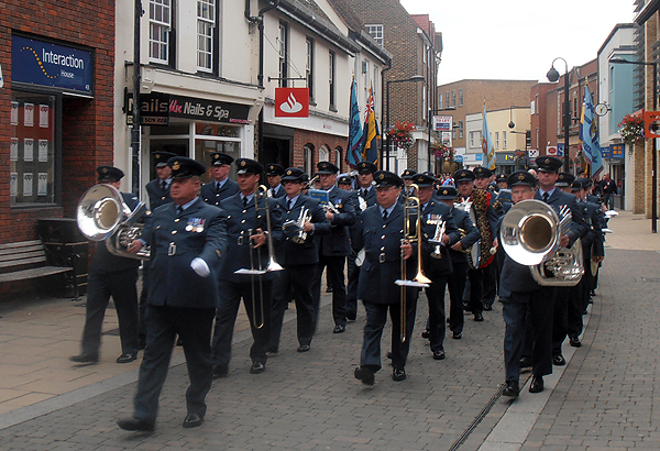 The parade marches through the Town Centre