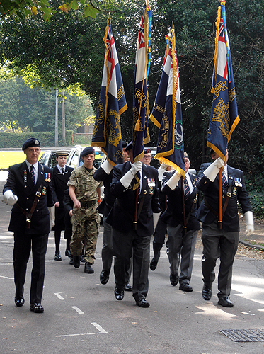 S/M Dave Corrigan marches the Standard Bearers to take up their positions