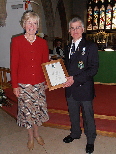 Lady King is presented a certificate from Bletchley RNA