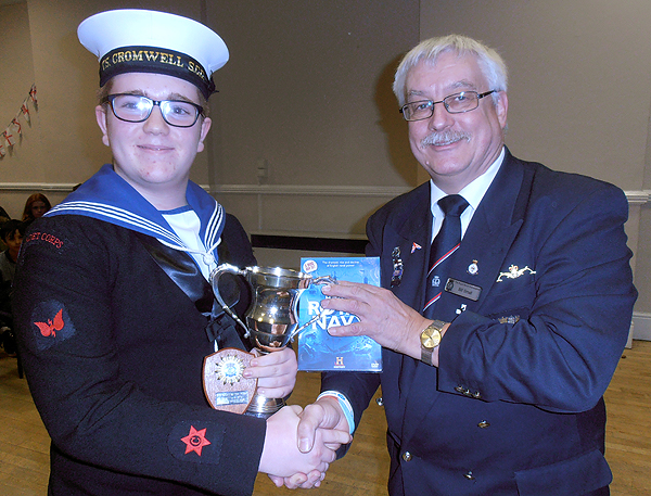 Cdt 1st Class Kieran Turner receives the RNA Cadet of the Year Trophy from S/M Bill Small