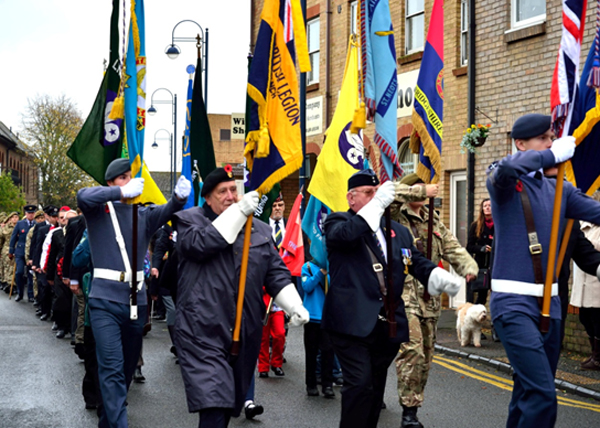 Veterans and youth group standards lead the parade in St Neots