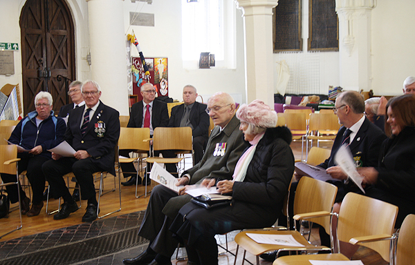 Shipmates take their seats in St Mary's Church