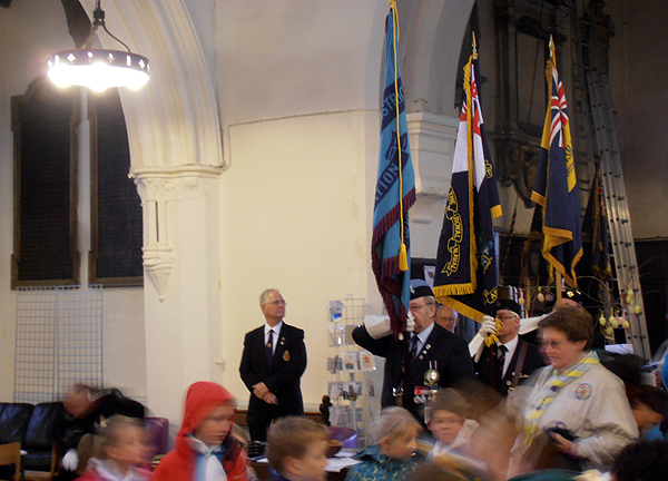 Standards are paraded down the aisle for the start of the Service