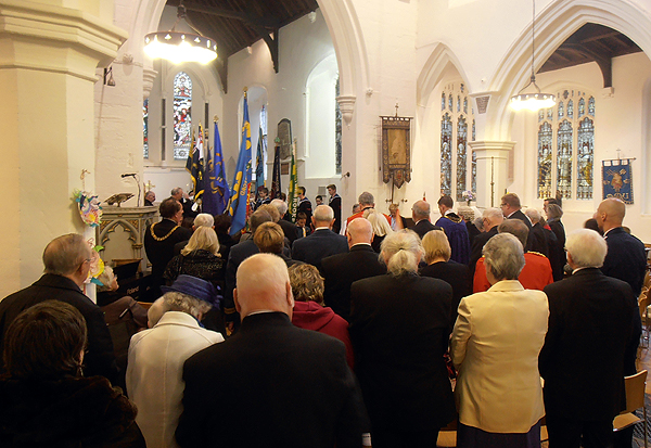 Members of the Royal Society of St George and guests stand for the National Anthem