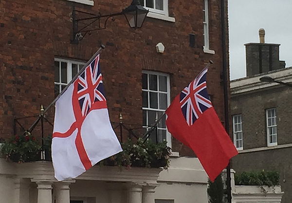 The Royal Naval and Merchant Navy ensigns are flown from the Town Hall