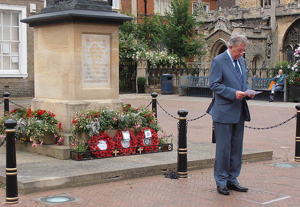 Wreaths at the base of the War Memorial as Derek Bristow thanks those who have attended the service
